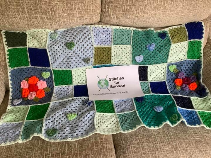 Crocheted blanket and stiches for survival logo