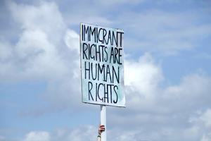 "Banner saying ""Immigrant rights are human rights"""